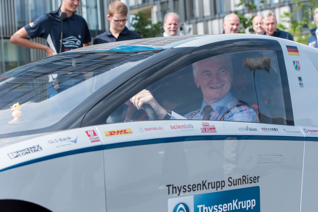 Dr. Heinrich Hiesinger seems be enjoying himself behind the wheel of the solar sports car