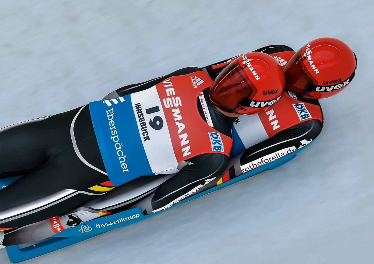 Toni Eggert and Sascha Benecken's luge speeds down the curves of the ice-covered track at 120 km/h